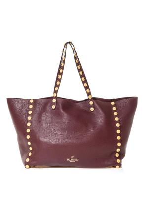 Gryphon-studded leather tote